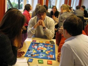 People playing cultureQs, the Change Accelerator board game